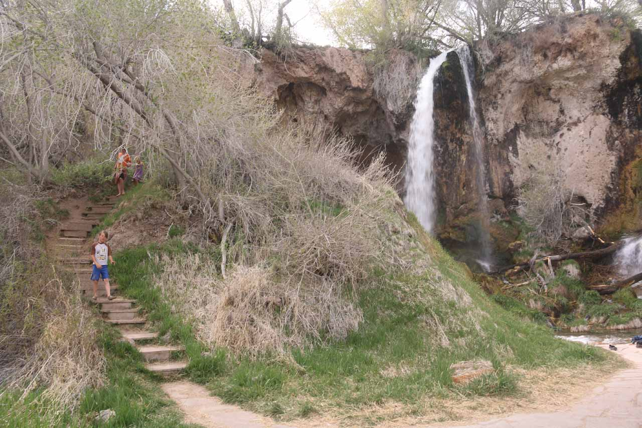The steps to the left led up to a profile view of Rifle Falls as well as an alcove where we could look out from behind one of the segments of the falls