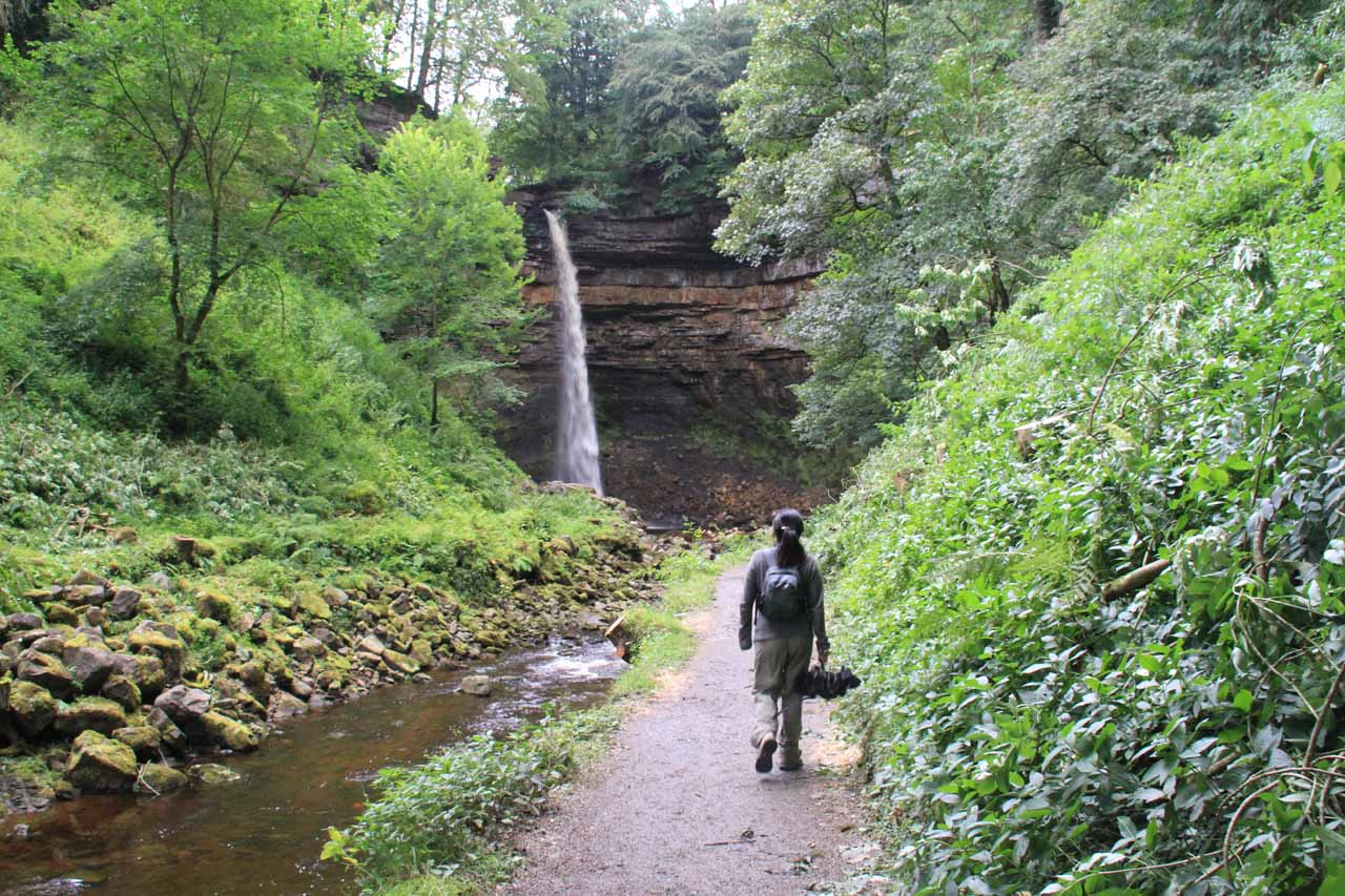Julie approaching Hardraw Force within the Hardraw Scar