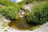 Harmony_Falls_067_06252021 - Direct look across an inviting plunge pool towards Harmony Falls
