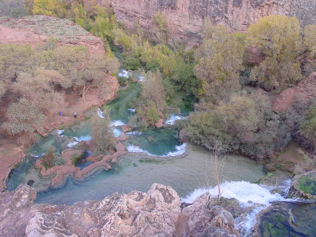 Looking down at the beautiful pools and travertine dams from the brink of Havasu Falls in November 2002