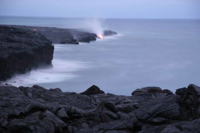 Hawaii_Volcanoes_NP_065_03102007 - Lava flowing into the sea in twilight