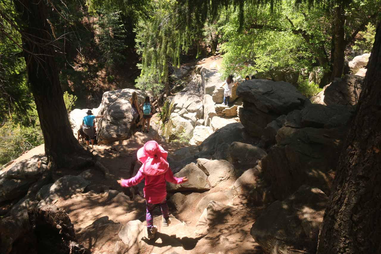 Tahia scrambling down to where the commotion was, which happened to be the overlook of the Heart Rock Falls