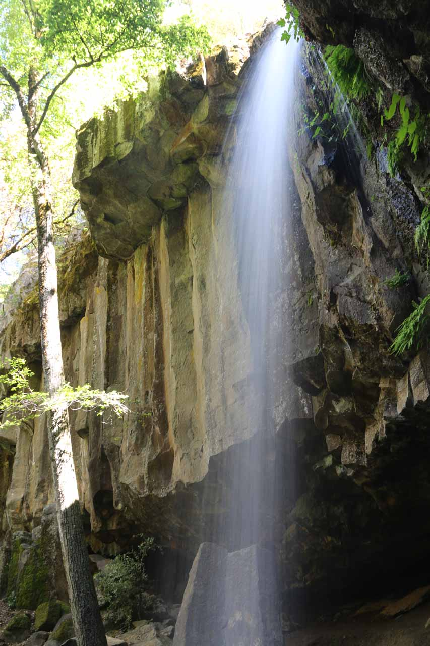 Looking up past Hedge Creek Falls towards the interesting overhanging basalt columns flanking it