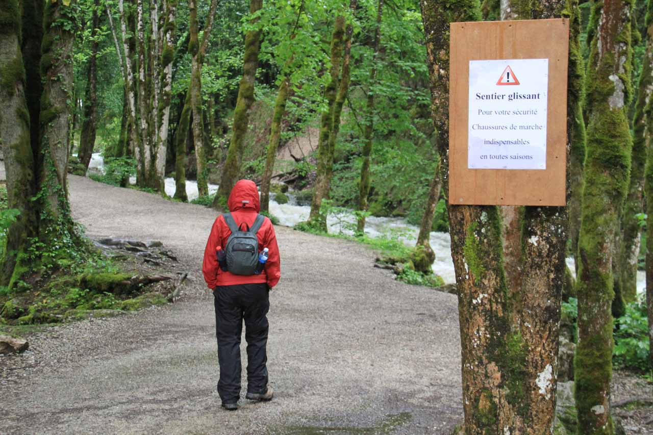 Warning sign indicating the trail is slippery