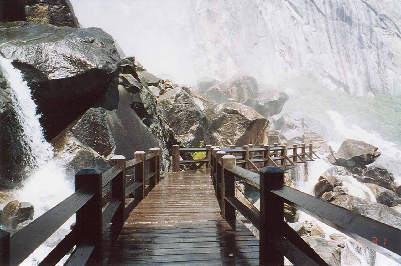 Flooded and misty trail beneath Wapama Falls