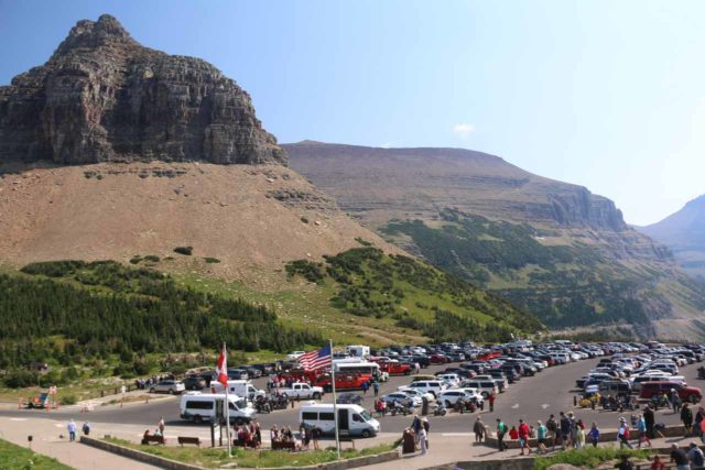 Hidden_Lake_004_08062017 - Looking back at the busy parking lot at Logan Pass, which was where the Hidden Lake Overlook Trail began