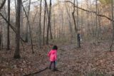 High_Banks_Twin_Falls_025_03162016 - Julie and Tahia passing through a grove of thin trees starting to sprout new leaves for the Spring en route to the High Banks Twin Falls