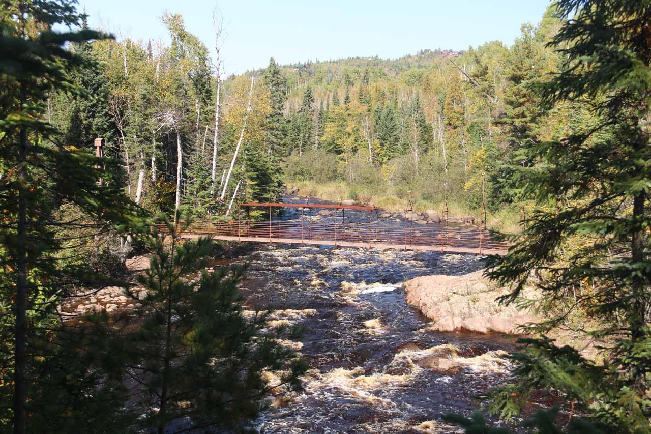 Looking upstream at the swinging bridge traversing the Baptism River