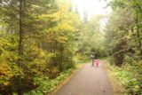 High_Falls_Grand_Portage_012_09262015 - Hints of Autumn colors were showing up as Julie and Tahia continued on the paved walkway leading to the High Falls of the Pigeon River on the Minnesota side