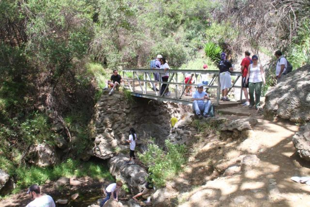 Hike-a-thon_030_04292012 - A lot of people lingering around the footbridge by the Temescal Canyon Falls