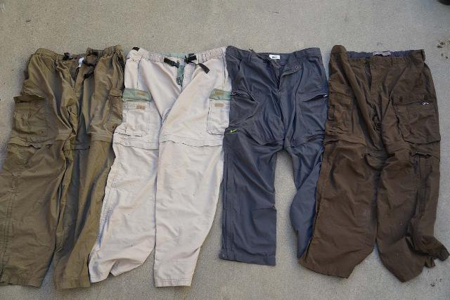 This is a series of 4 different versions of REI Co-op Sahara Hiking Pants that we've owned and used over the years with the oldest on the left and the newest on the right