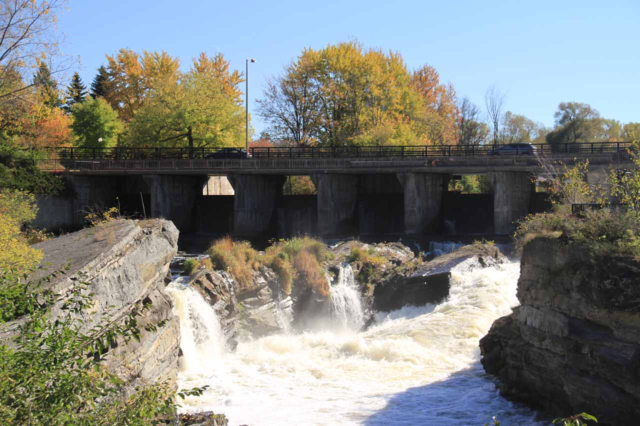 Looking upstream at the 8m Hogs Back Falls with dam walls beneath the foot bridge and road bridge