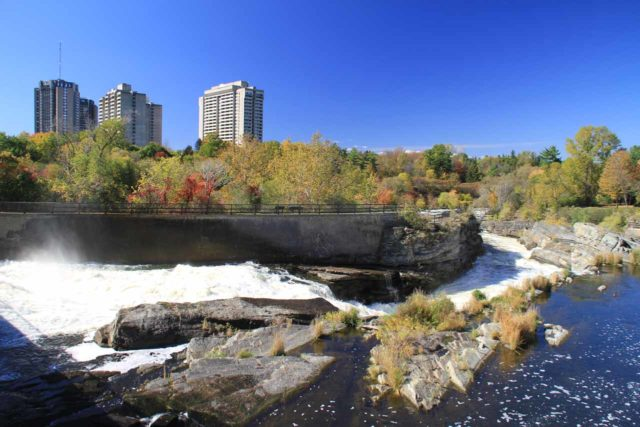 Hogs_Back_045_10092013 - Looking over the brink of Hogs Back Falls (Prince of Wales Falls) towards the high rises of Ottawa as seen from the bridge and dam controlling the flow of the Rideau River