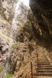 Hollentalklamm_166_06262018 - The Hoellentalklamm Trail about to pass beneath some side waterfalls and some weeping cliffs high up in the gorge