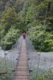 Hollyford_Track_006_12242009 - Julie on the swinging bridge at the start of the Hollyford Track