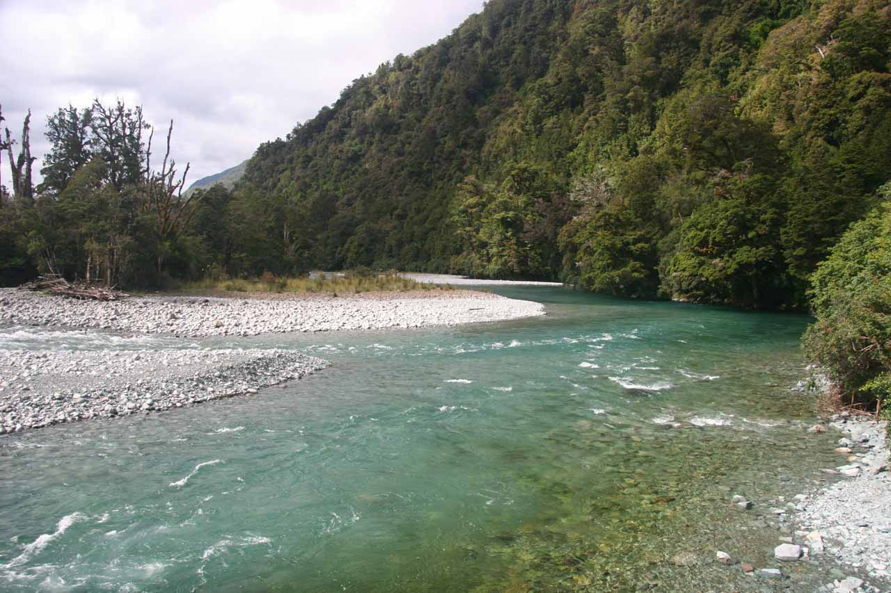 Looking towards the colourful yet crystal clear waters of the Hollyford River along the Hollyford Track