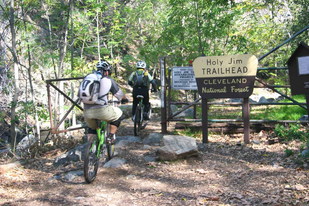 Mountain bikers going past the official trailhead