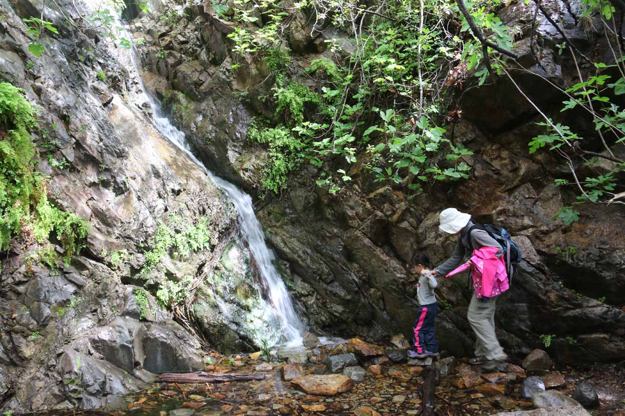 Julie and Tahia getting right up to the base of Holy Jim Falls
