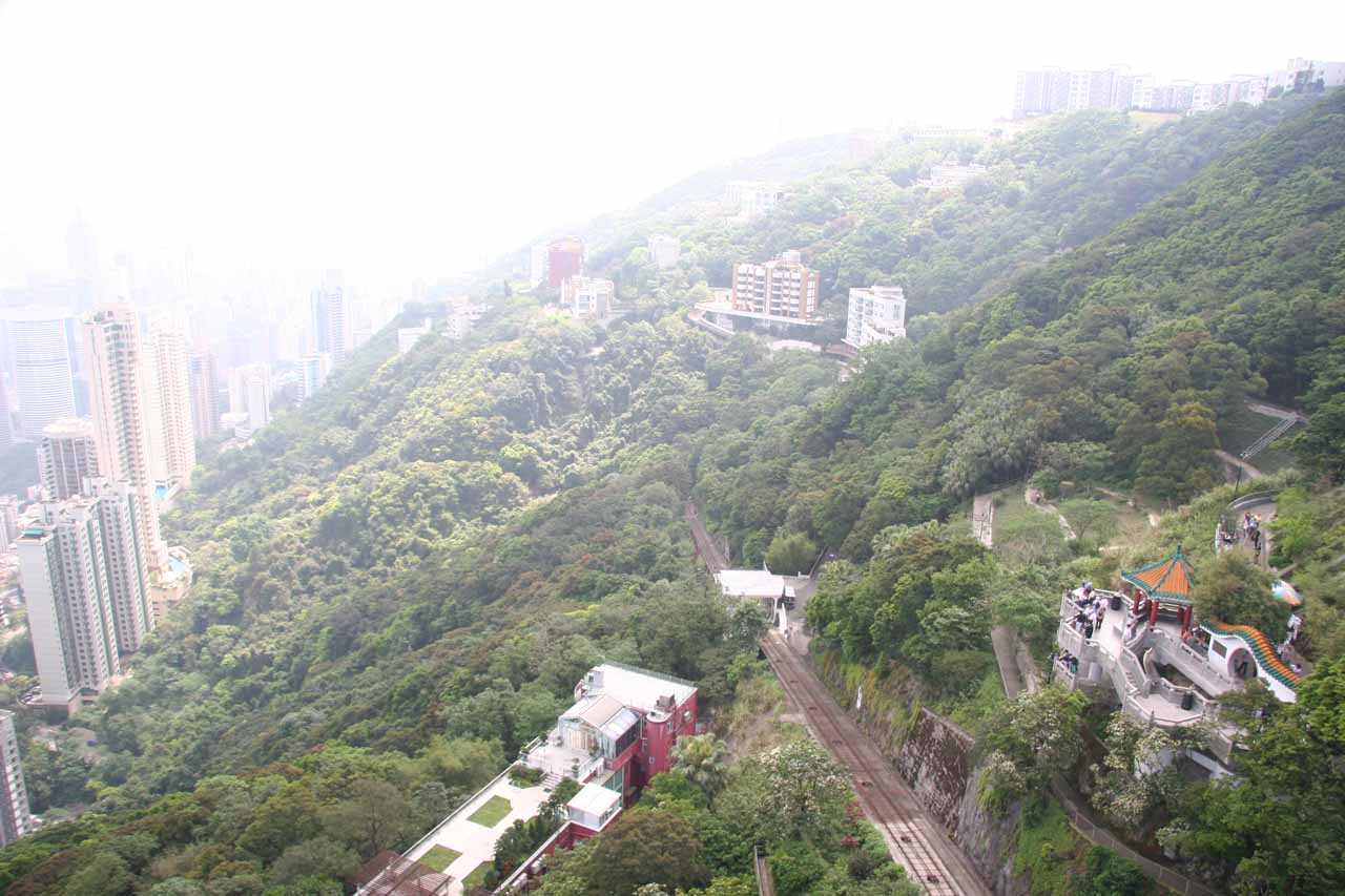 Looking back down at the tracks of the funicular in context with the Victoria Peak panorama