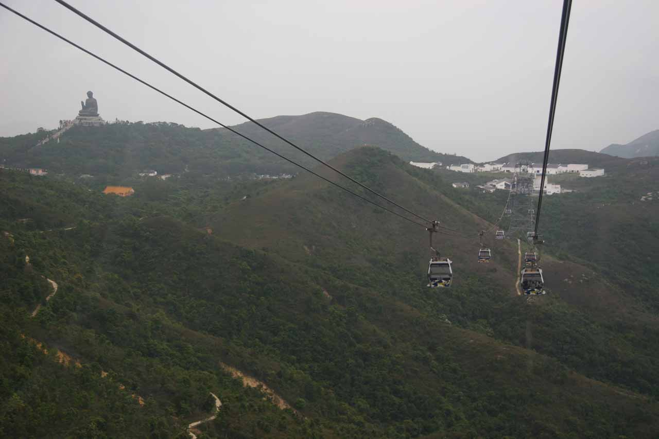 On the cable car with Buddha in the distance