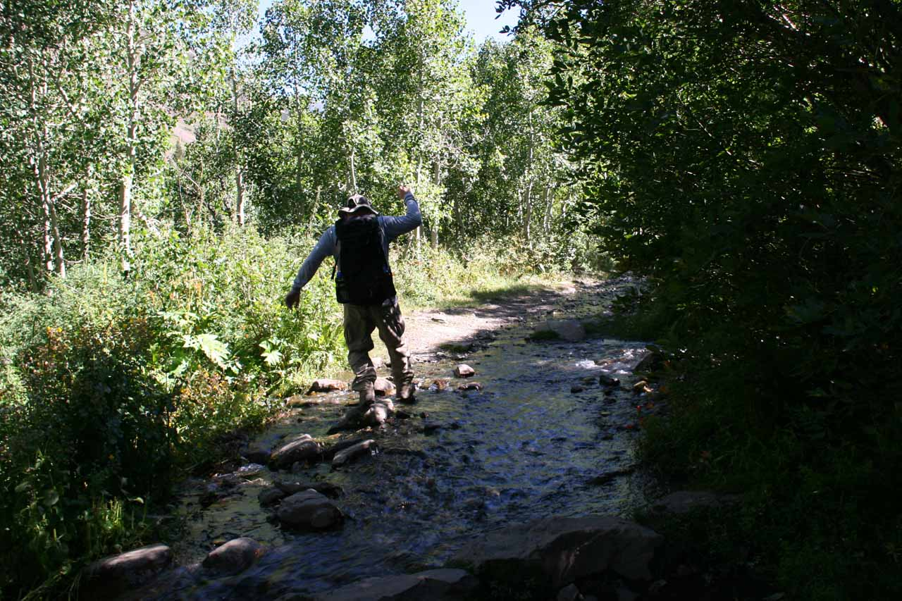 Ed rock hopping to keep his feet dry while crossing Horsetail Creek