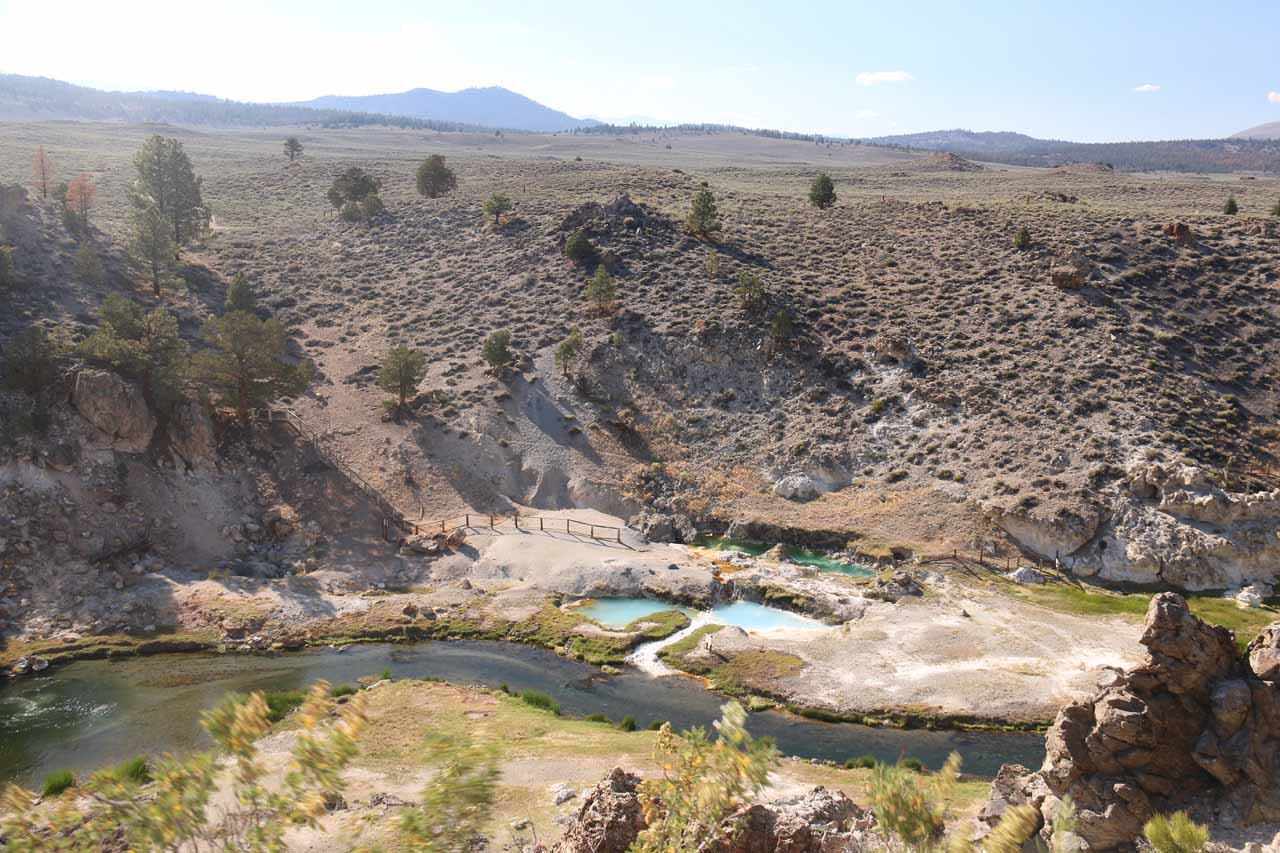 Looking over Hot Creek towards some colorful geothermal pools adjacent to it
