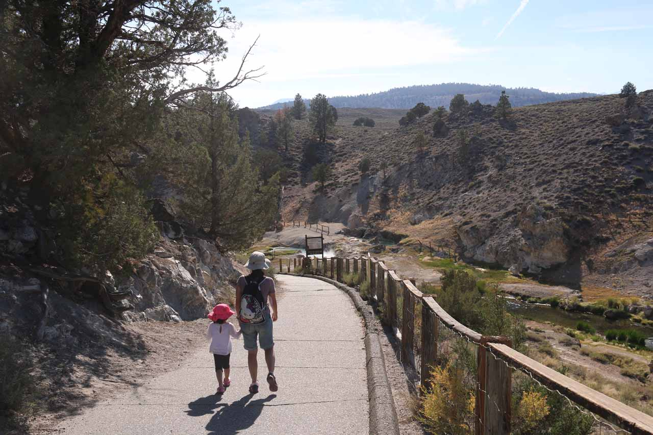 Julie and Tahia walking towards the creek bed of Hot Creek