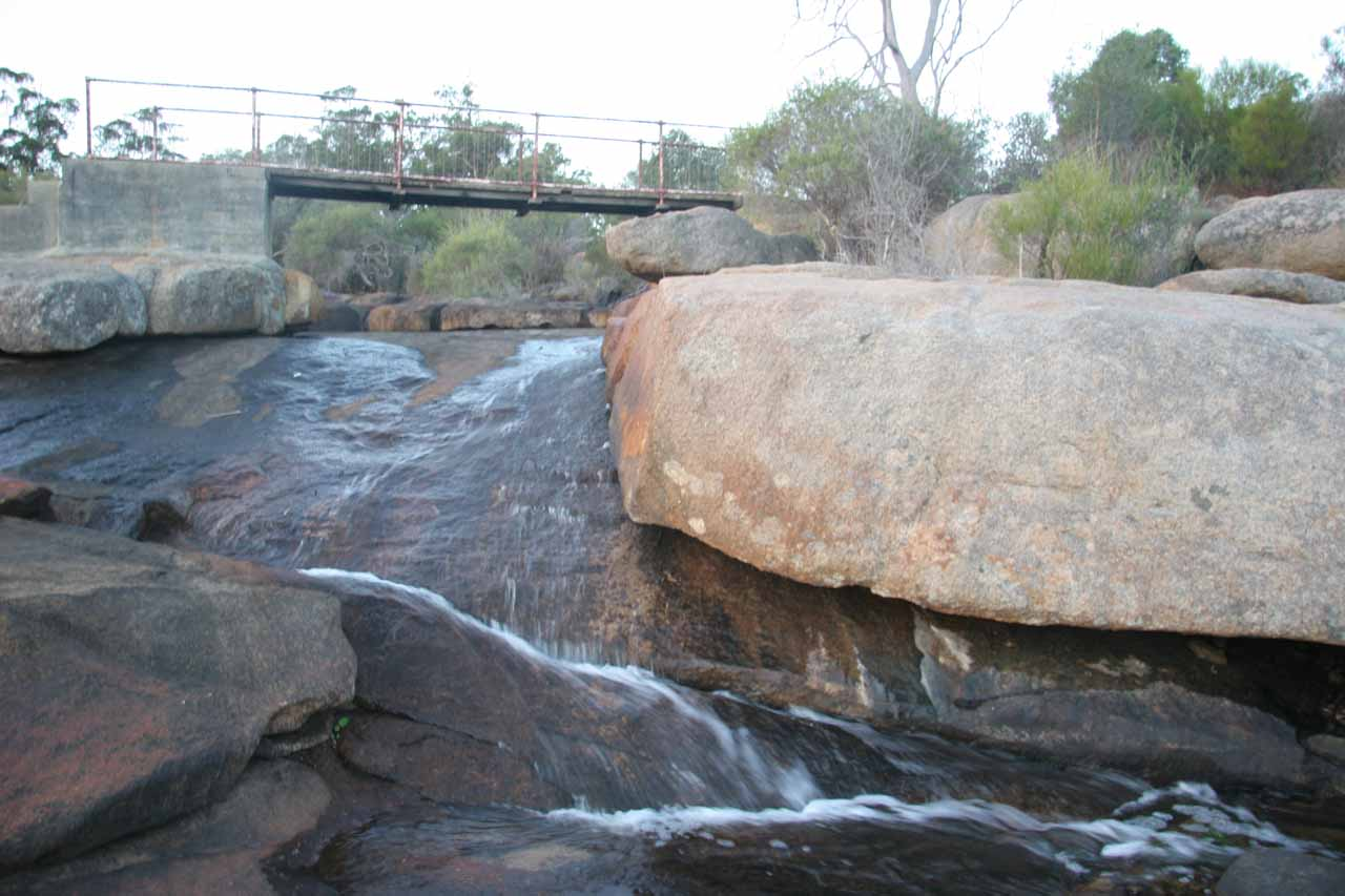 Frontal view of a part of the Hovea Falls looking back up towards the footbridge