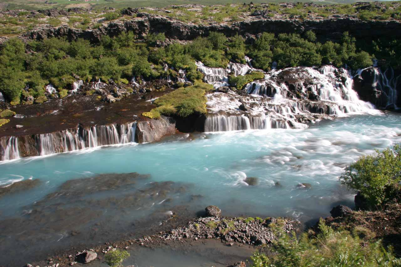 Looking back across the main part of Hraunfossar with the bright blue Hvita River passing before it