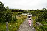 Hraunfossar_049_08182021 - Mom and Tahia approaching the next lookout for the Hraunfossar Waterfalls