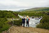 Hraunfossar_075_08182021 - Context of some ladies checking out both Hraunfossar and the lookouts opposite the percolating springs as seen from the lava field on the same side of the Hvita River as the falls themselves