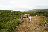 Hraunfossar_099_08182021 - Context of Tahia checking out the Hallmundarhraun Lava Flow on the other side of the footbridge