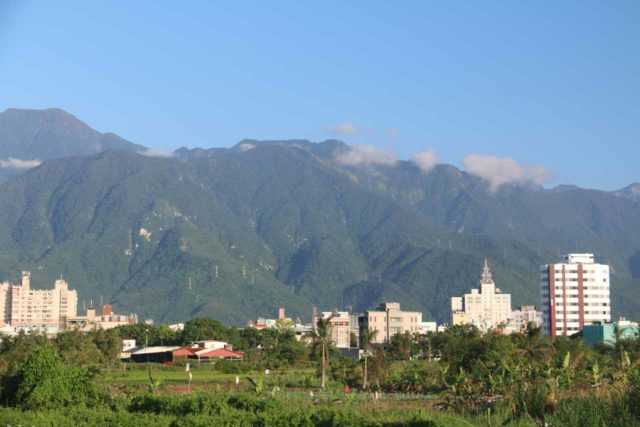 Hualien_087_10272016 - Tall mountains backed the farmlands and towns lining the coast and rift valley along Eastern Taiwan. Shown here were tall mountains backing Hualien City
