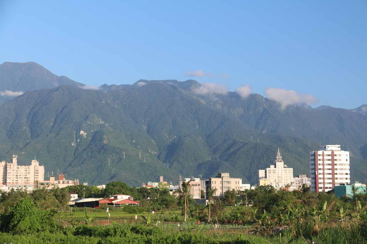 Tall mountains backed the farmlands and towns lining the coast and rift valley along Eastern Taiwan. Shown here were tall mountains backing Hualien City