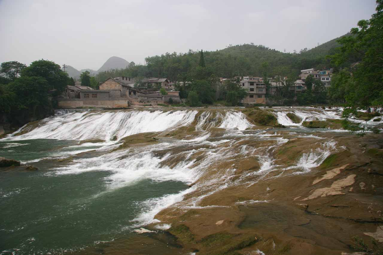 A small but wide waterfall seen on the road descending down towards the Huangguoshu Scenic Area