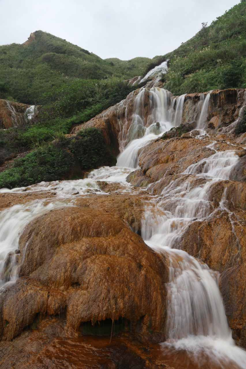 Closer look at part of the Huangjin Waterfall and its underlying colored rock surface