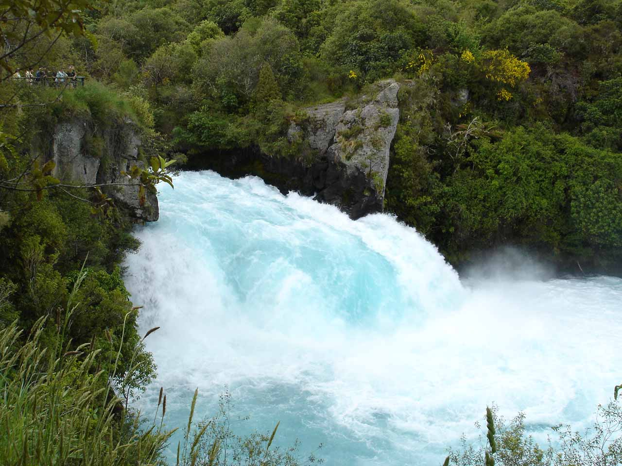 Brighter look at the turbulence of Huka Falls dwarfing onlookers at the top