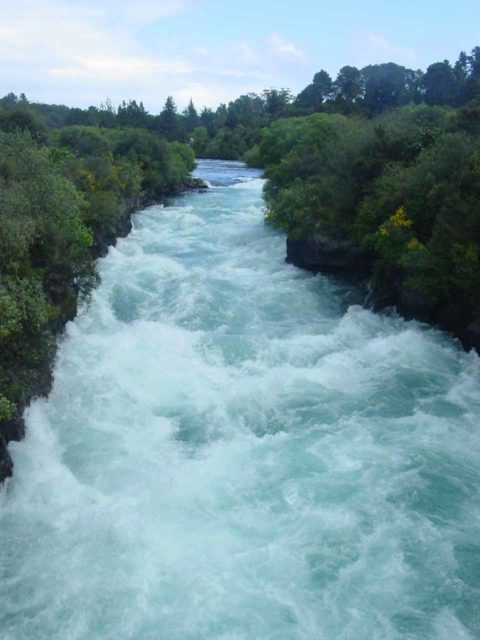 Huka_Falls_026_11152004 - Looking upstream from the footbridge over the Waikato River where the watercourse squeezes into the narrow gorge and results in a bit of turbulence