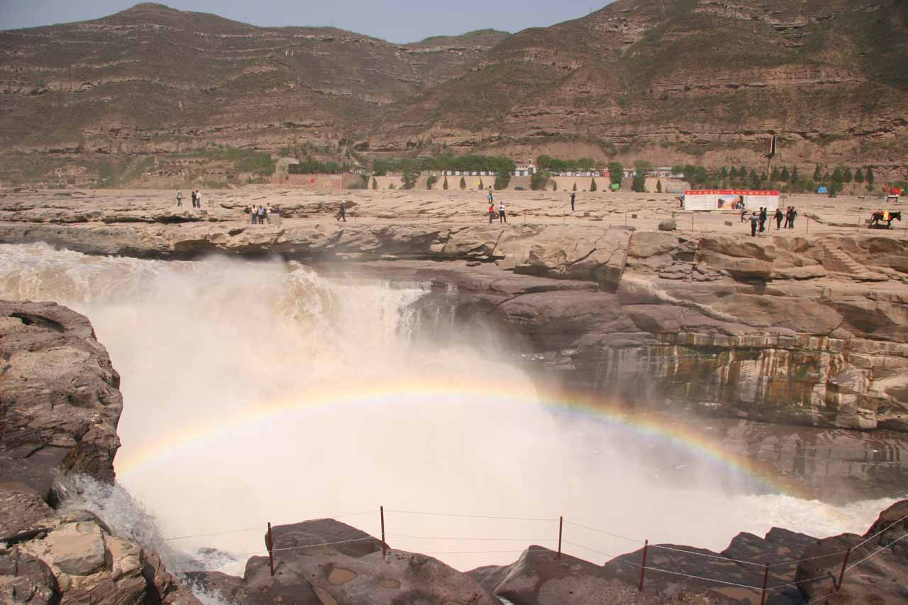 Rainbow within the brownish waterfall of Hukou