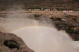 Hukou_032_05032009 - Zoomed in and focused look at the turbulence of the Hukou Waterfall while throwing up enough mist to yield this nice rainbow