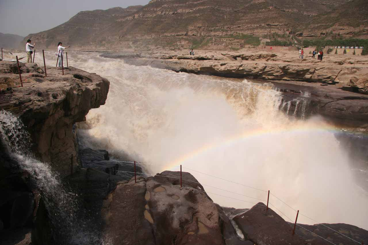 Some Chinese tourists getting their photos of the Hukou Waterfall
