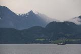 Hurtigruten_day2_122_06302019 - Looking towards a rain storm in an adjacent valley while cruising the Sunnlyvsfjorden en route to Geirangerfjorden