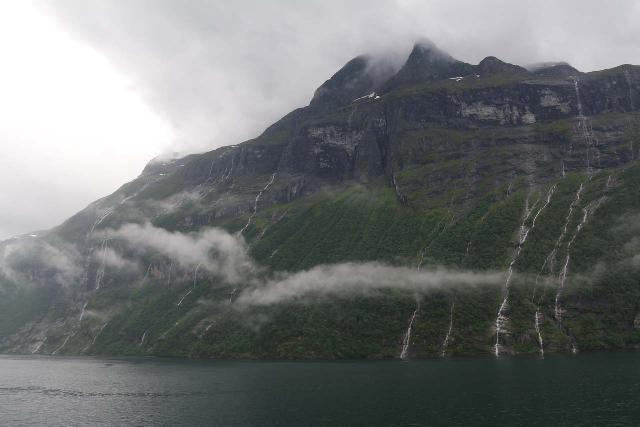 Hurtigruten_day2_242_06302019 - At the confluence of the Geirangerfjord and Sunnylyvsfjord were numerous ephemeral waterfalls tumbling down this mountain during the storm on our late June 2019 cruise aboard the Hurtigruten