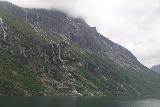 Hurtigruten_day2_435_06302019 - Lots of waterfalls coming down like veins on this mountain at the mouth of Geirangerfjorden