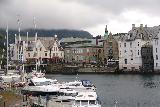 Hurtigruten_day2_506_06302019 - Looking across the water at the Alesund harbor towards some old-looking buildings in the distance