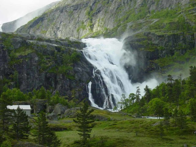 Husedalen_117_06242005 - This is Nykkjesøyfossen, which was the third of the Husedalen Waterfalls. Note the cabin, which was one of a handful of them on this hike, and it made me wonder if this was how Husedalen got its name