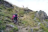 Hvitserkur_060_08152021 - Mom carefully making her way back up to the overlook of Hvitserkur