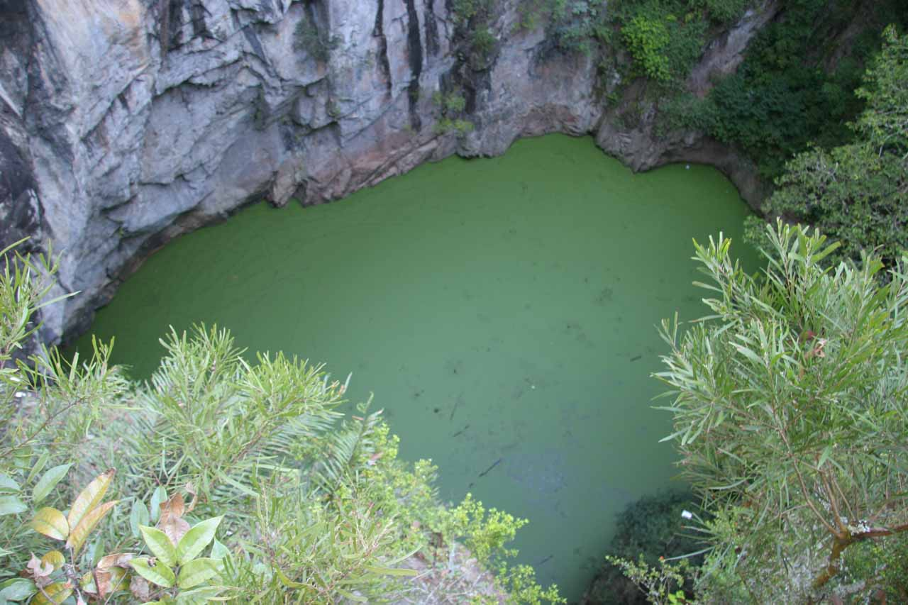 Looking down at the stagnant green pool at the Hypipamee Crater