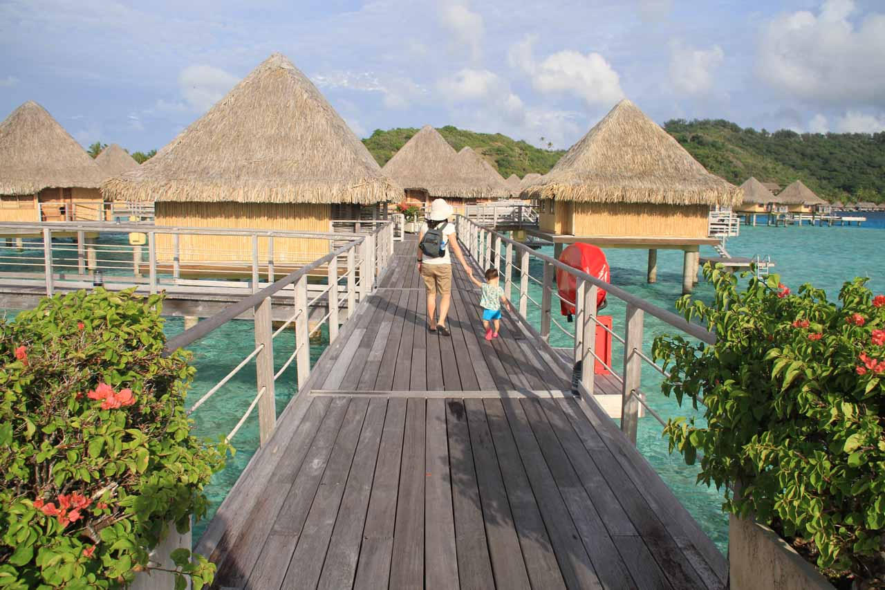 Julie and Tahia walking amongst the overwater bungalows in Bora Bora
