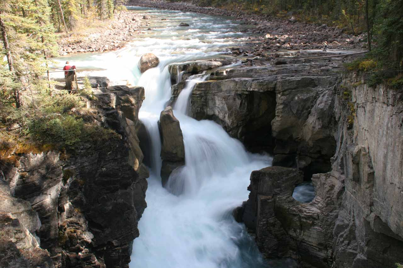 Closeup view of Sunwapta Falls with some onlookers right at its brink